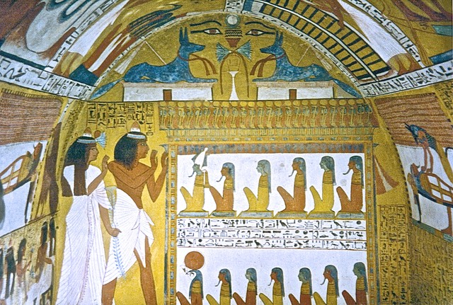 Almost all Ancient Egyptian tomb paintings are done on a background of yellow ochre, such as this wall in the Tomb of Sennedjem. Photo © D K Hitchins, 1992.